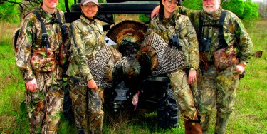 "I was SO happy to get this Big Rio on the ground. Just so happend a jake comae in and provided the perfect decy bringing that Gobbler in. This was definitely a group effort with (L-R) Jason Nash, Becky Lou, BIG BIRD, Cristie Gates & Joe Googan. This hunt was filmed in 2011 for an episode of 'Benelli on Assignment"" for the Outdoors Channel Turkey Hunt #2. Episode can be seen on You Tube Here:There is also an article in Game & Fish online magazine."